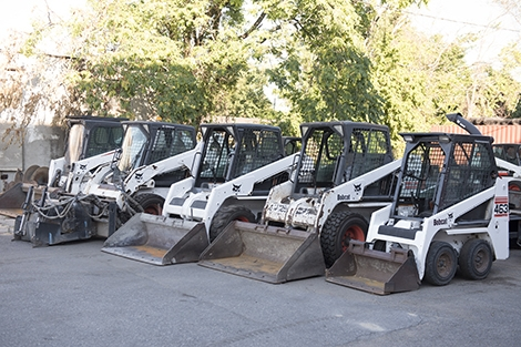 Four Bobcat skid-steer loaders sit outside the Landry Rental Center shop.