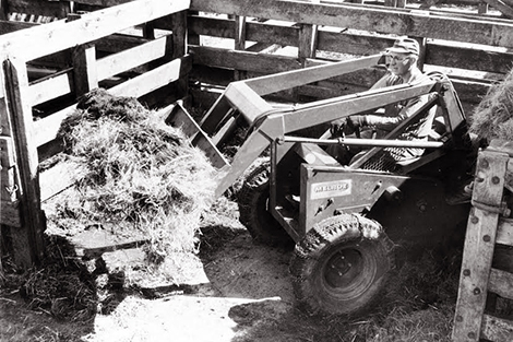 Cy Keller operates first self-propelled loader, the M60, at the West Fargo Stockyards in 1958.