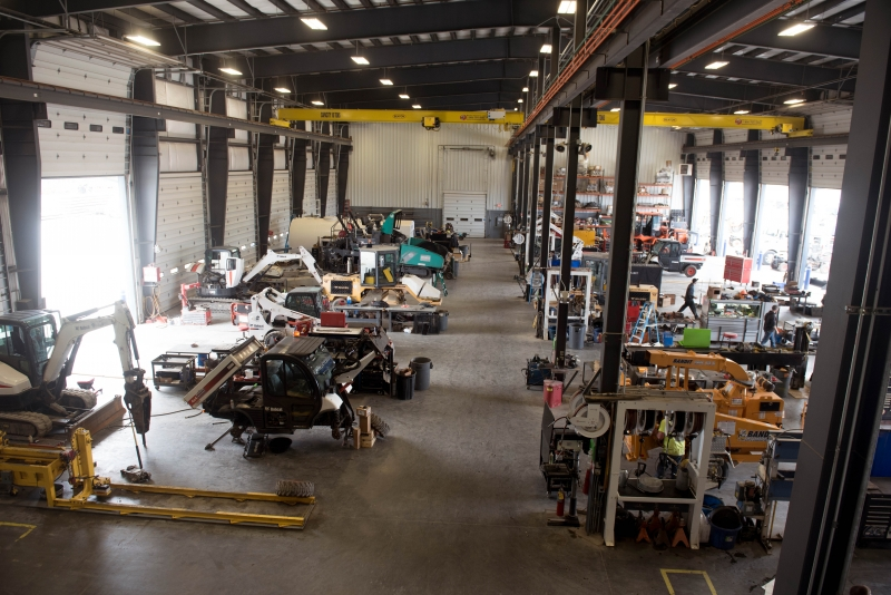 Overhead view of Finke Equipment's 16-bay shop with service techs repairing equipment
