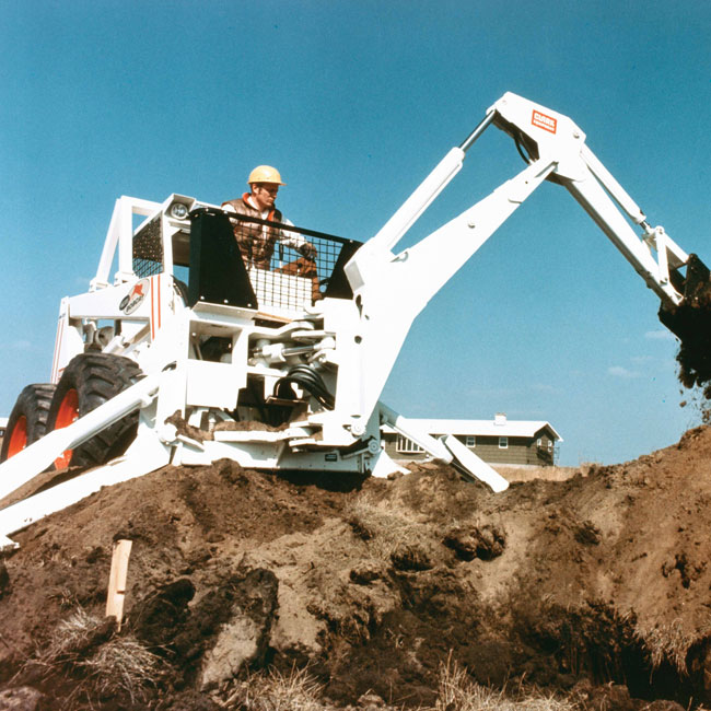 M970 with Backhoe
