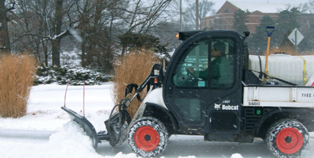 A Toolcat Utility Work Machine clears snow.
