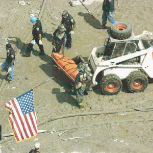 FDNY responders and a Bobcat 843 skid-steer loader recovering the body of a victim at ground zero.