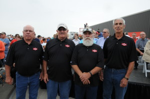 Brothers Warren, Curt, Wayne and Marcus Anderson stand for a photo together during the Bobcat Millionth Loader Ceremony