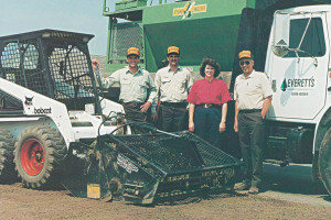 The Diemer family: Brian, Brent, Ellen and Everett, with their Bobcat 753 skid-steer loader in 1995.