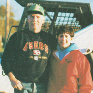Laddie and Mary Flock with their Bobcat 873 skid-steer loader in 1997.