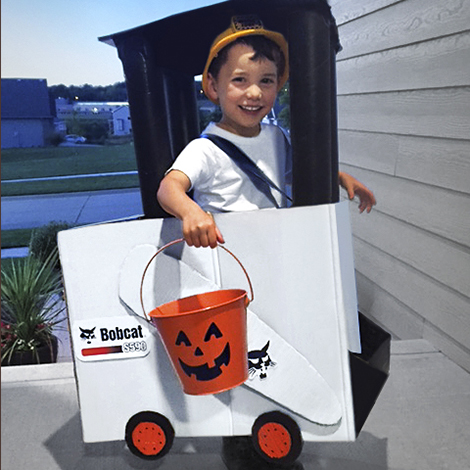 Child in Bobcat skid-steer loader Halloween costume