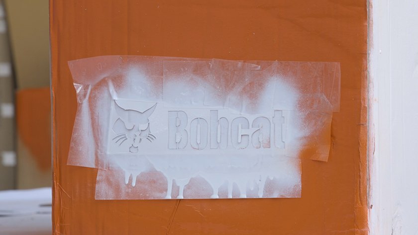 Step Fifteen: Spray-paint the Bobcat logo on the tailgate.