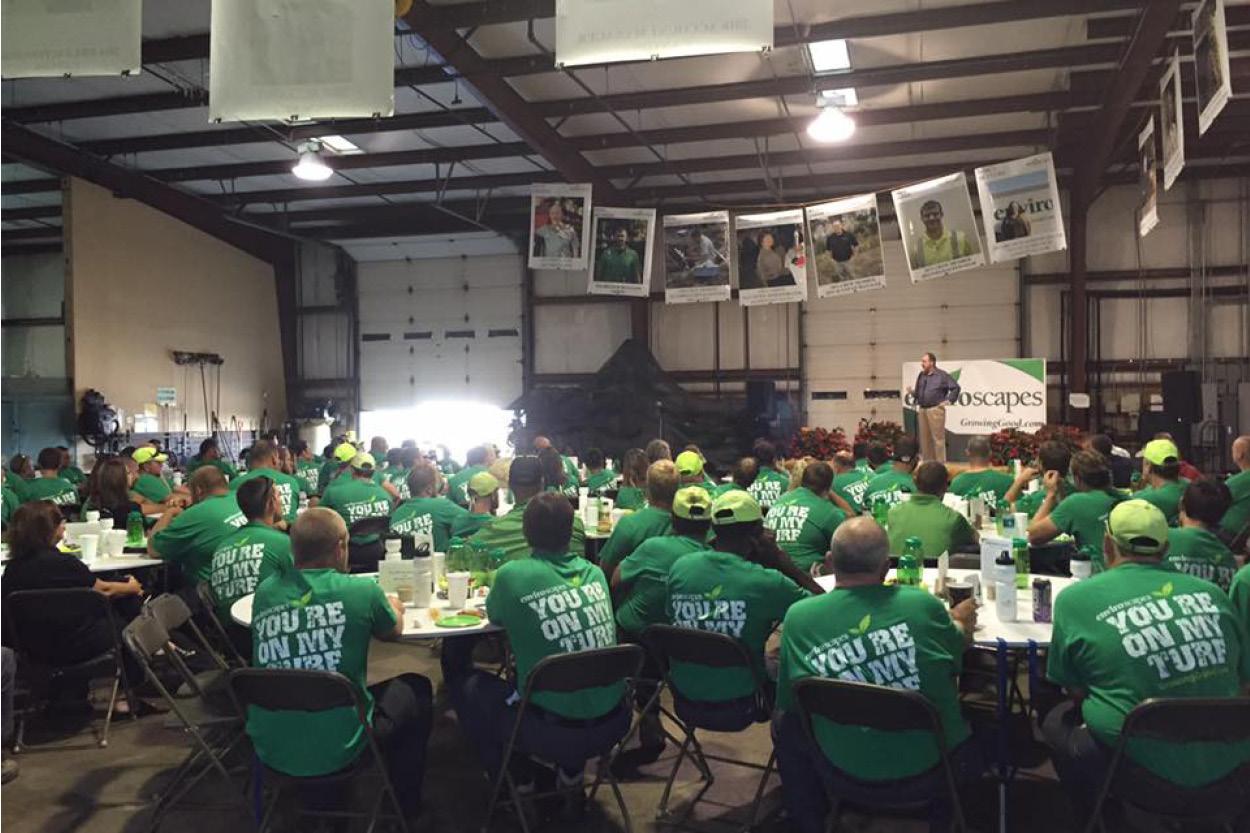Enviroscapes employees gather to listen to a speaker during Growing Day.