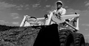 Worker operates a Melroe Bobcat loader
