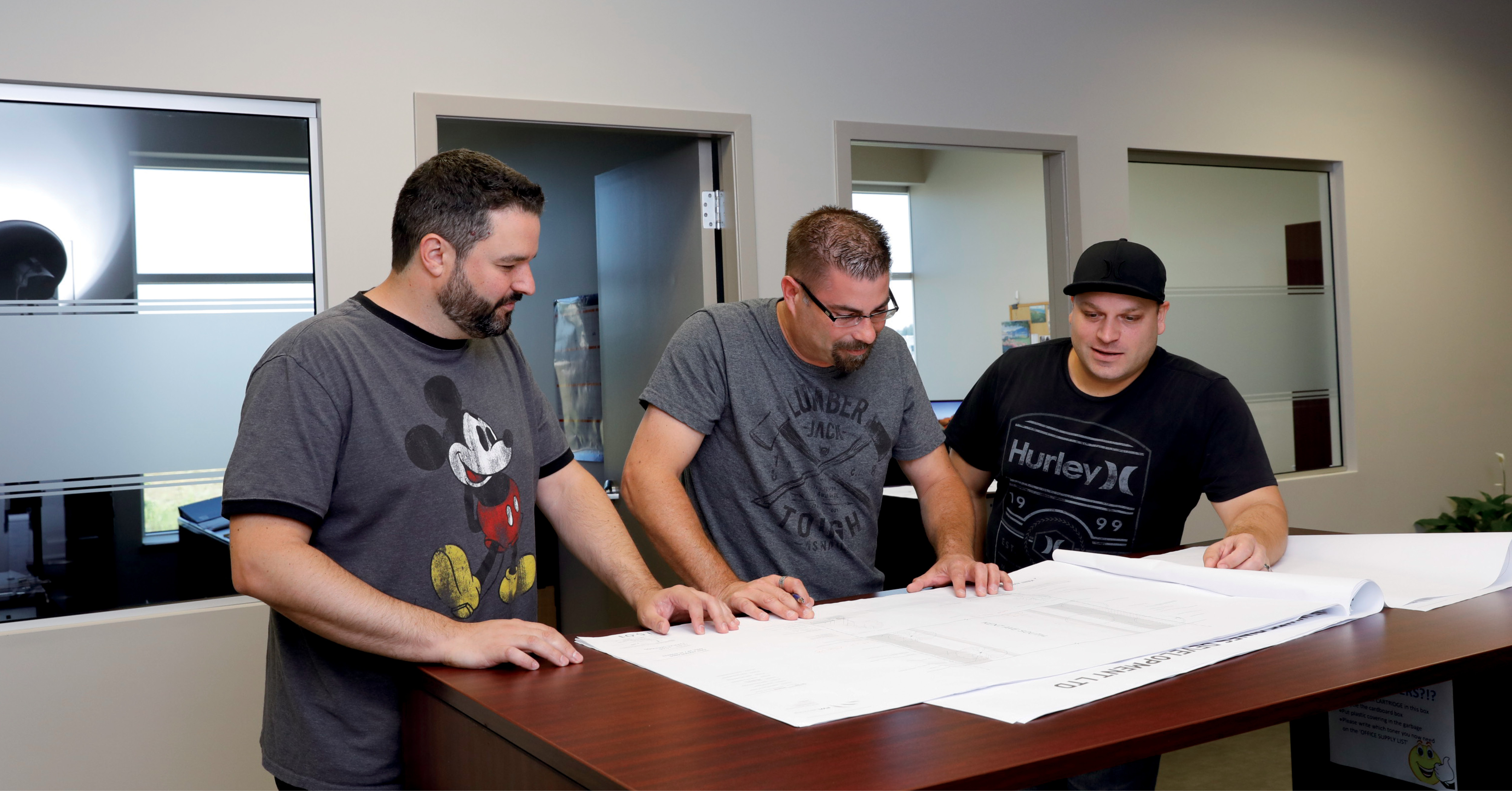 Mike Lalonde reviews landscaping design plans with employees