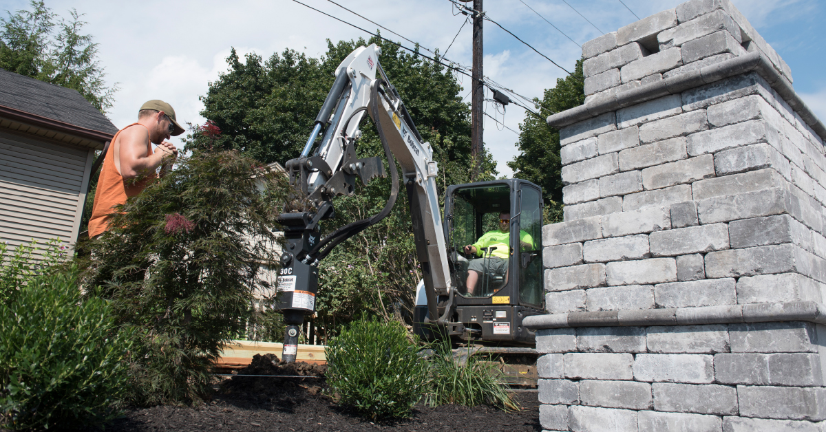 Kyle Brown digs fence post holes with his R-Series E32 compact excavator