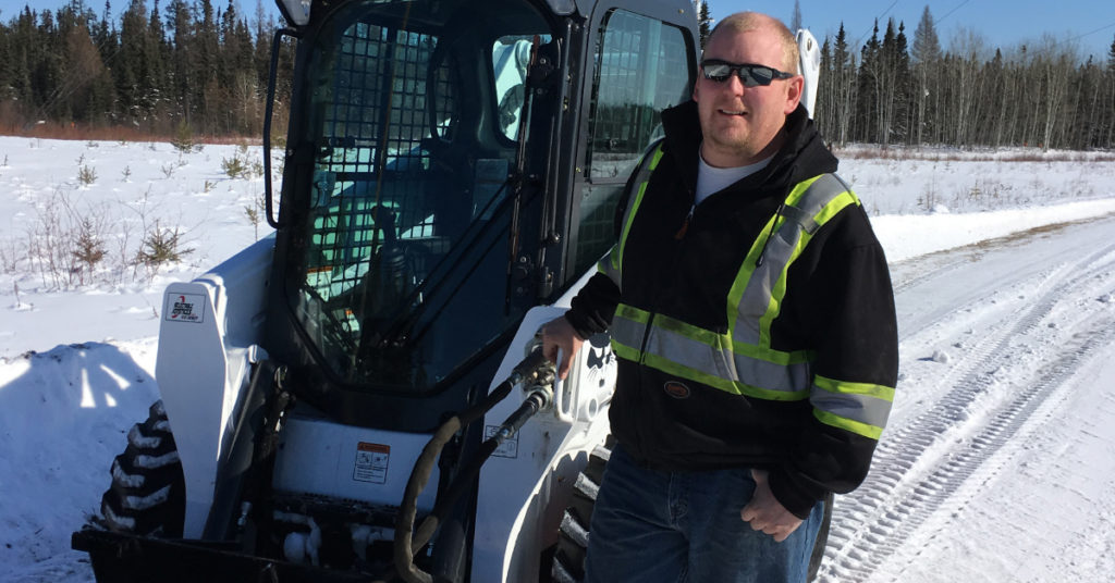 Mathew Zetterstrom stands next to use S570 while out removing snow.