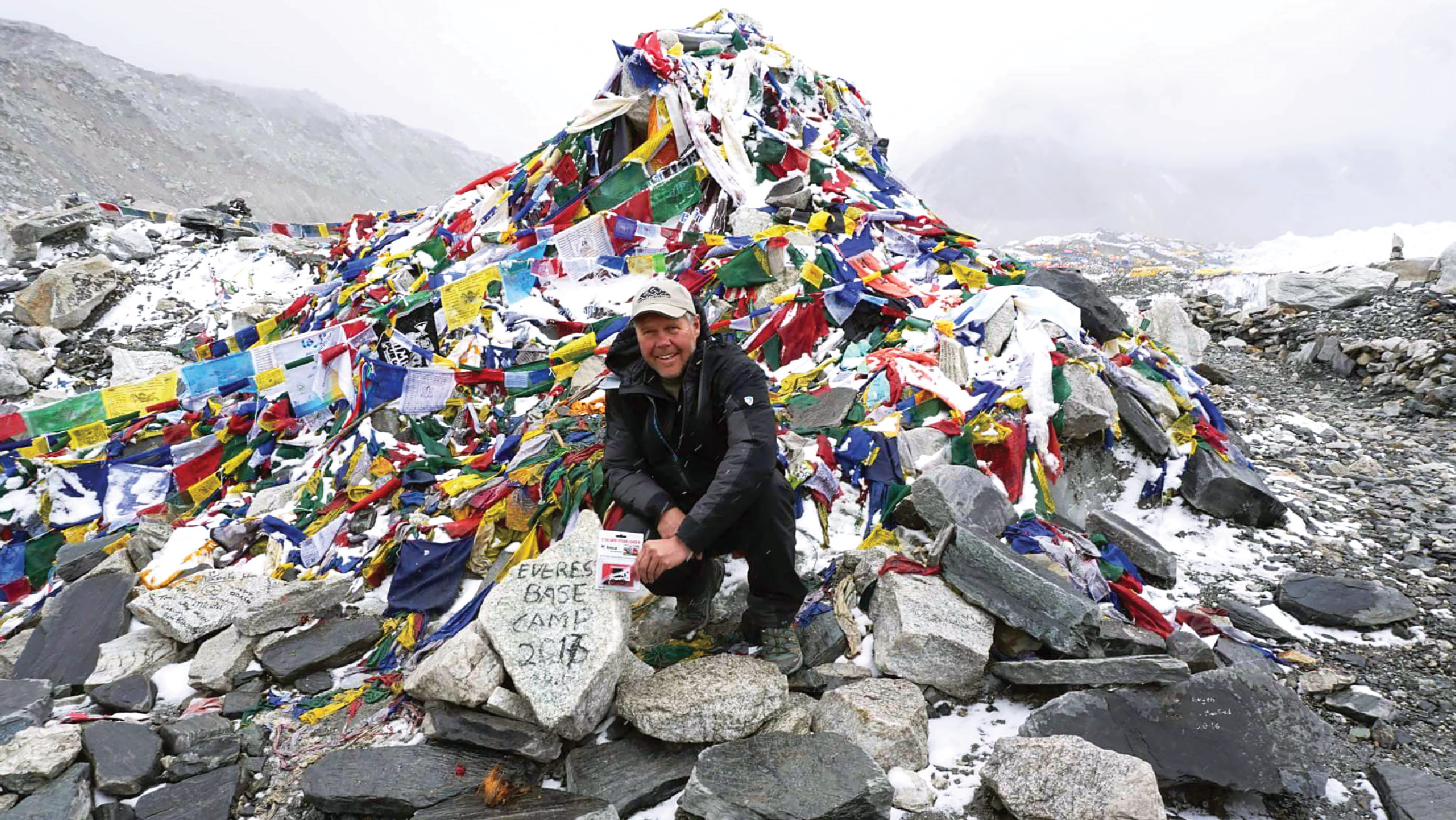 Deny Farnworth holds a Bobcat scale model loader at Base Camp on Mt. Everest