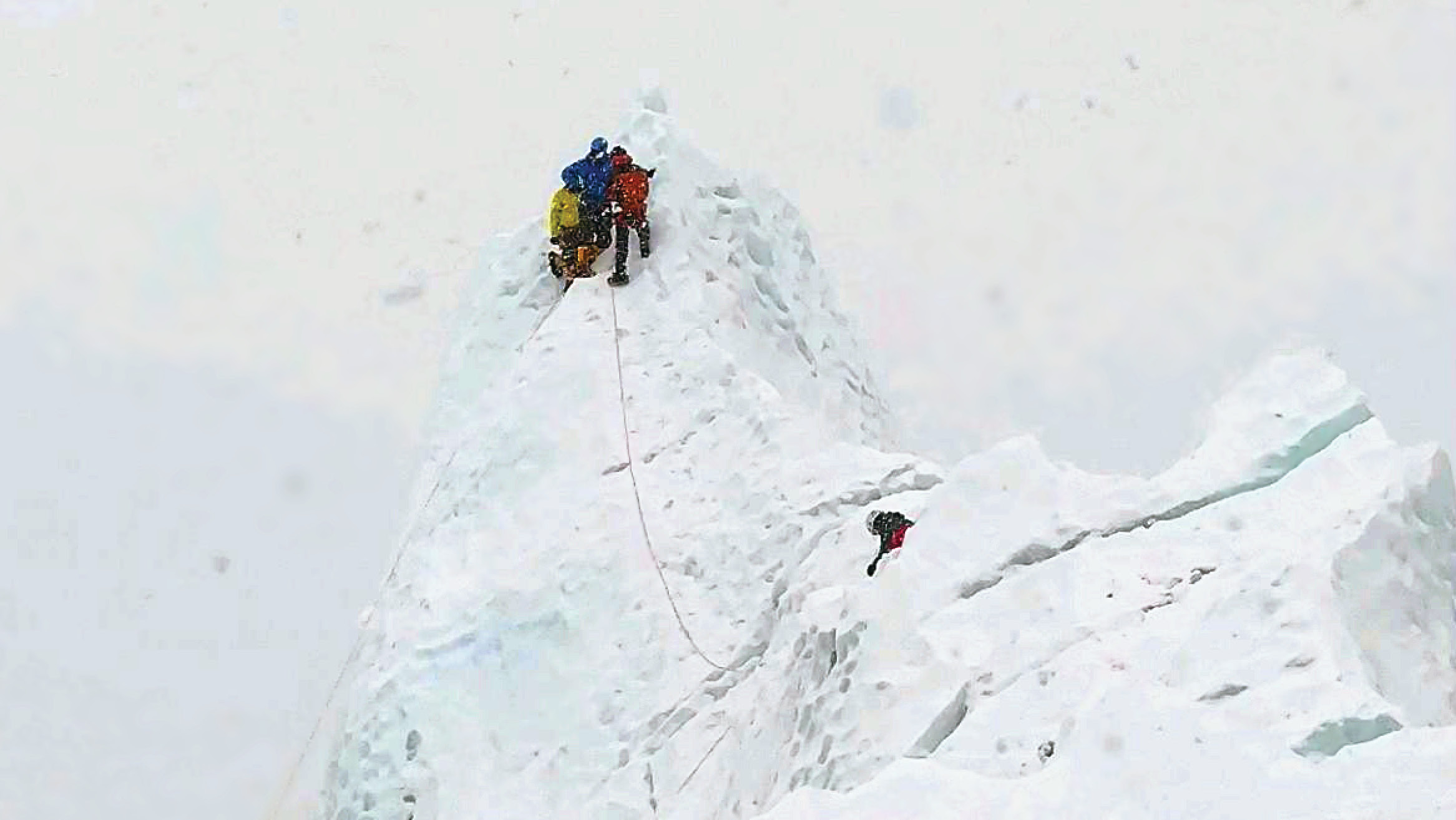 Deny Farnworth climbing Mt. Everest with other climbers.