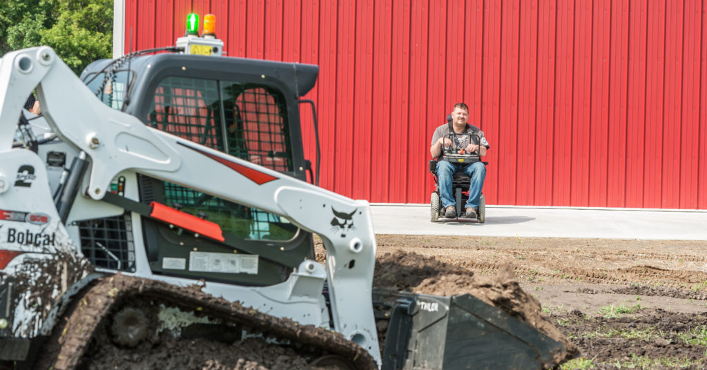 Trevor moves dirt with his T595 compact track loader using the radio remote control system.