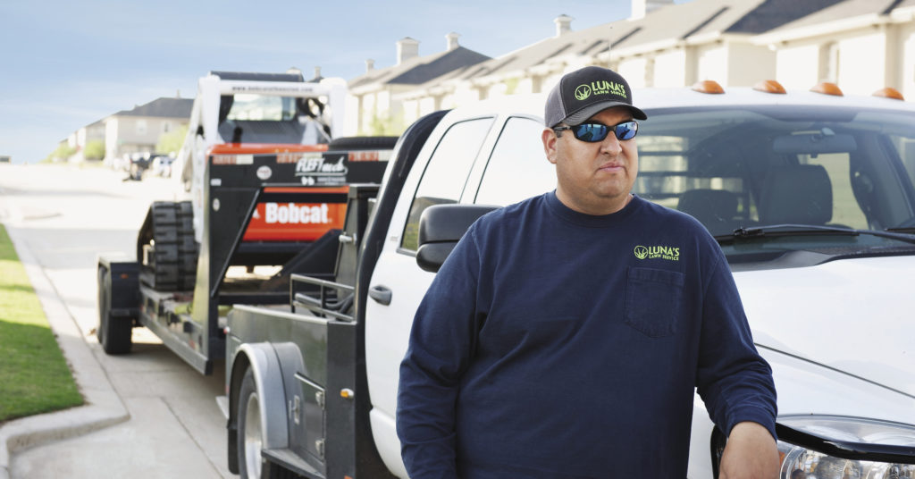 Bo Luna, owner of Luna's Lawn Service, pictured with a Bobcat T750 compact track loader.