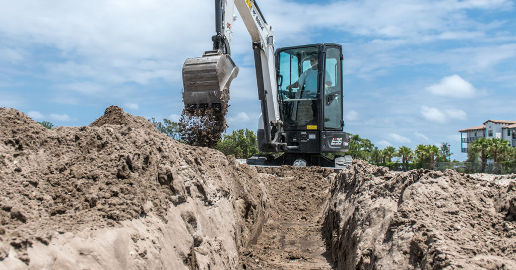 R-Series excavator with closed cab digs with bucket