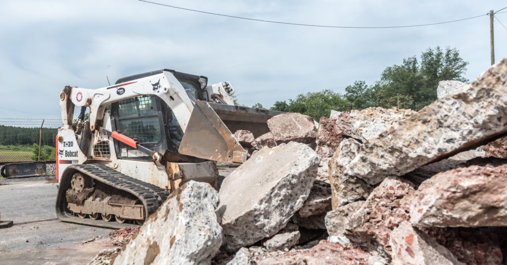 T740 compact track loader moving broken concrete