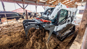 Bobcat T650 with industrial grapple attachment