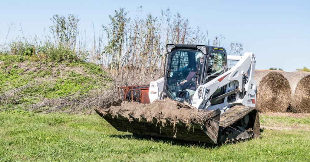 Bobcat compact track loader in a field