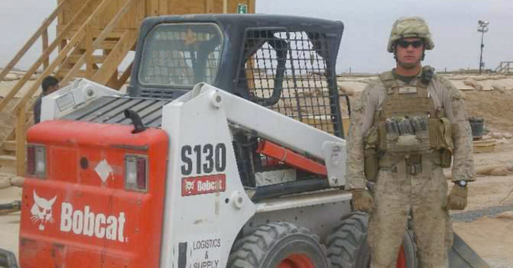 U.S. Marine Peter Freundschuh and a Bobcat skid-steer loader in Afghanistan.
