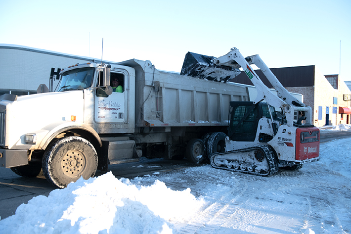 Bobcat Compact Track Loader Loads Snow Into Truck