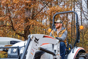 Carson Wentz operating a Bobcat compact tractor.