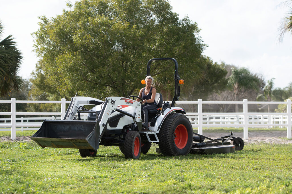 Jodi D'Amico Mows Grass On Her Acreage Using Rotary Cutter Attachment On Compact Tractor