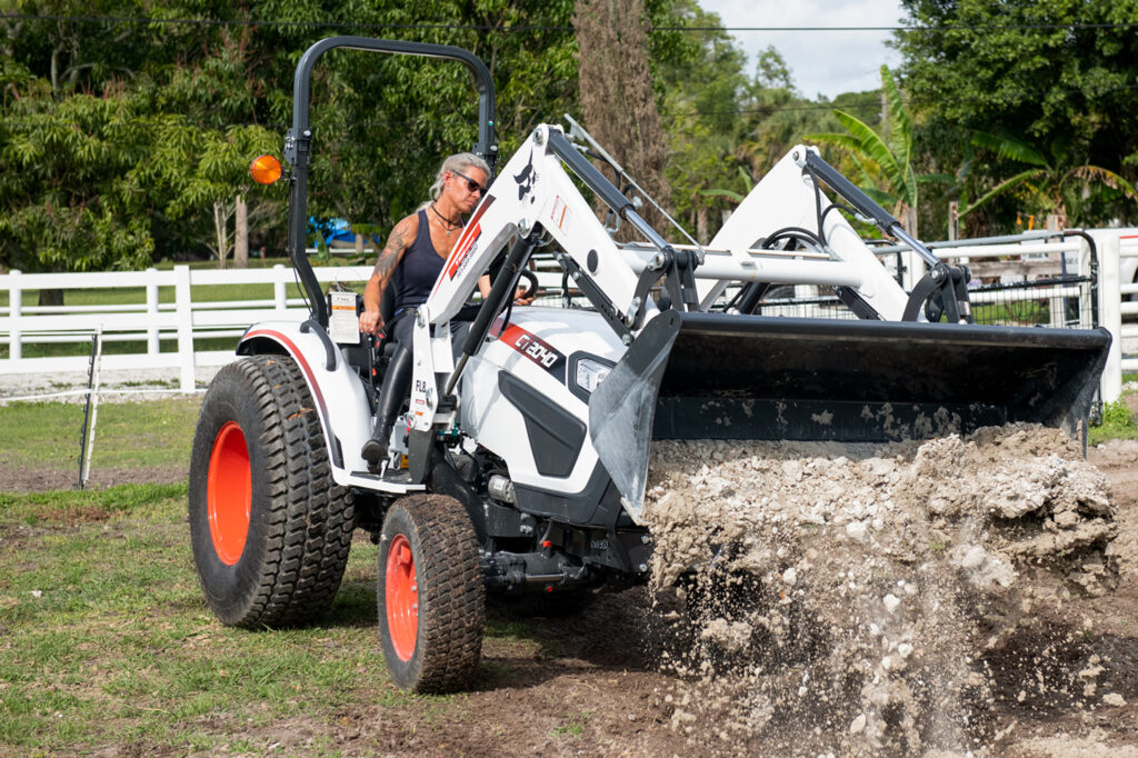 Jodi D'Amico Dumps Dirt With A Front-End Loader Attachment On Compact Tractor