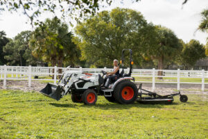 Jodi D'Amico Mows Her Property With A Rotary Cutter Attachment On A Compact Tractor