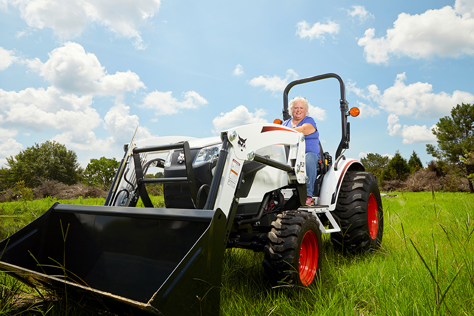 Bobcat Customer Drives Her Compact Tractor Through A Pasture