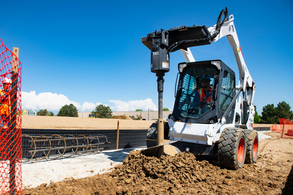 Bobcat Skid Steer Loader With Auger Attachment Drilling A Caisson