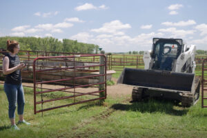Livestock Farmer Operates Compact Track Loader Using Bobcat MaxControl Remote Operation.