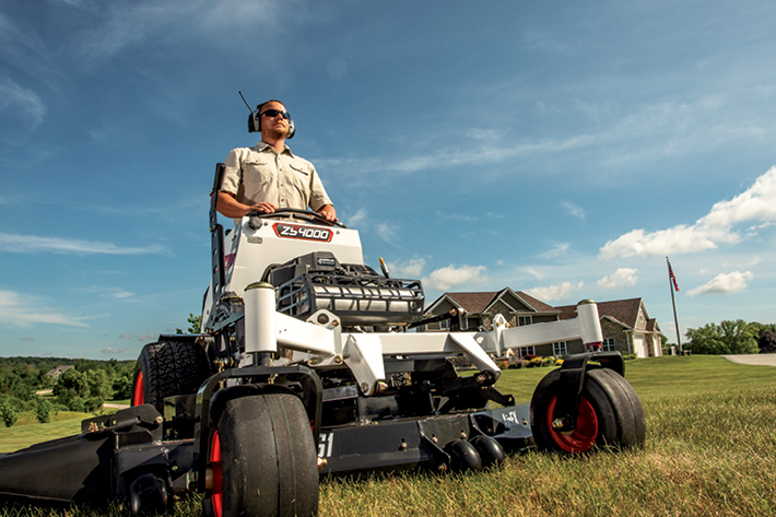 Landscaper Uses A Bobcat ZS4000 Riding Lawn Mower To Mow Residential Customer's Grass