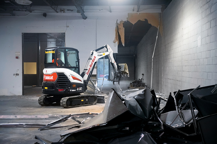 Bobcat Mini Excavator Doing Demolition Work For Interior Project