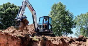 Bobcat Mini Excavator Digs For A Pool