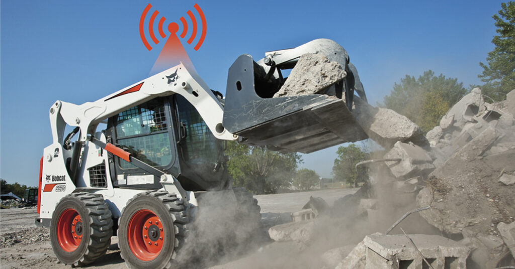 Bobcat Skid-Steer Loader Lifting Cement Blocks