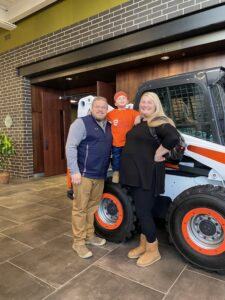 Teddy Danielson and his parents, Jessica and Ross, visited the West Fargo Bobcat facility.