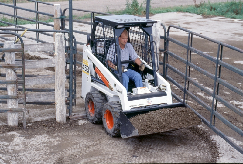 "Smallest of the Bobcat skid-steer loaders, the 453 ""mini-Bob"" continued to serve in tight quarters applications."