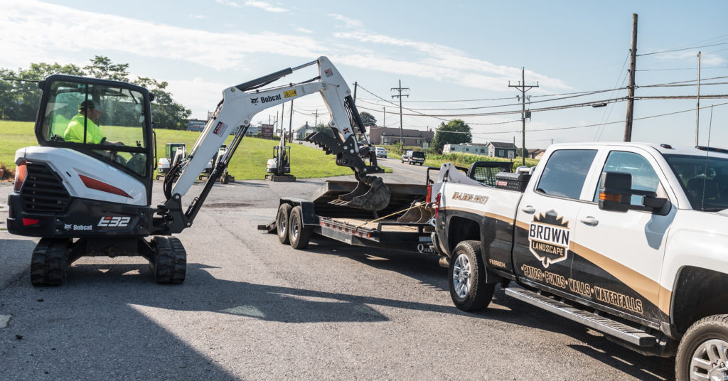 Kyle Brown loads his clean E32 Bobcat excavator onto a trailer.