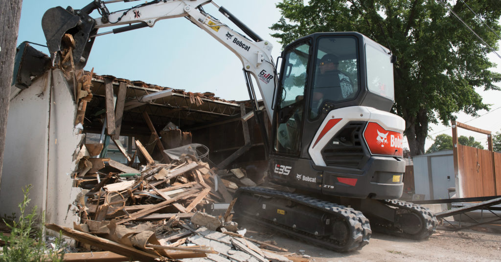Graeme Robertson tears down a garage using his R-Series E35 excavator.
