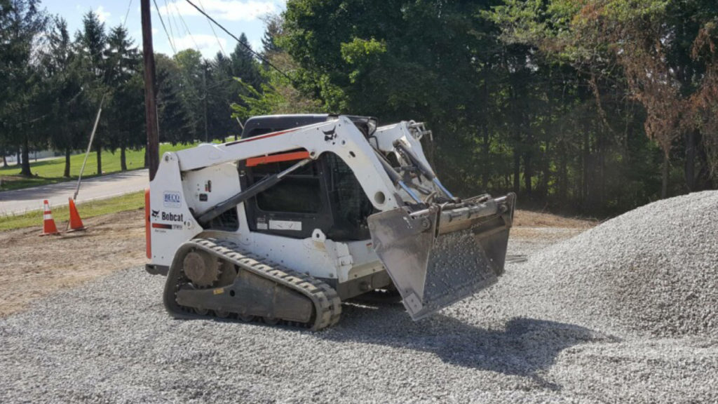 T630 compact track loader moving rock