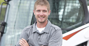 Headshot of Chris Menn next to his Bobcat T650 compact track loader