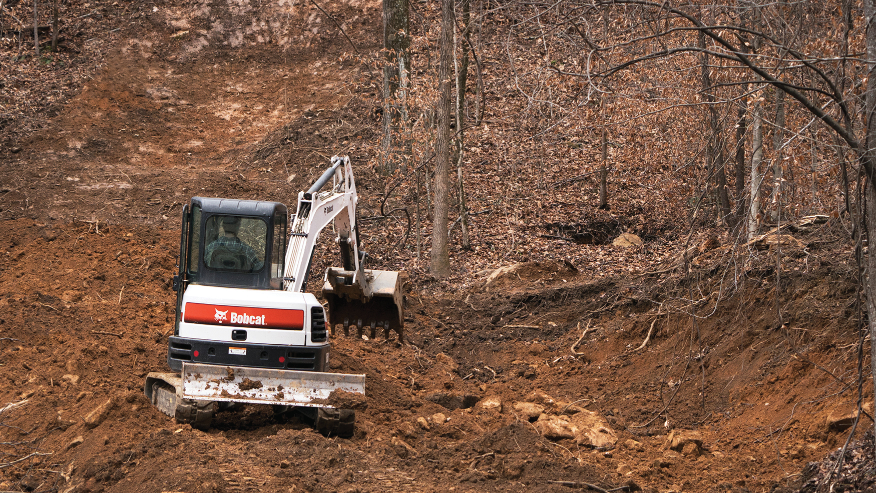 Mountain Bike Racers Build Downhill Course with Bobcat