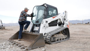 Todd Sharp climbs into his T650 compact track loader