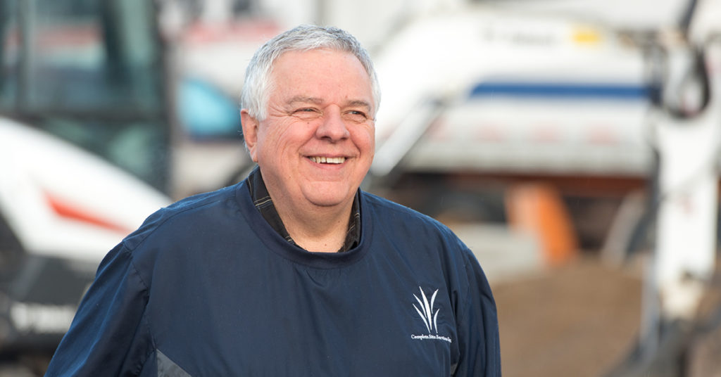 Headshot of waste management business owner, Rick Alischer