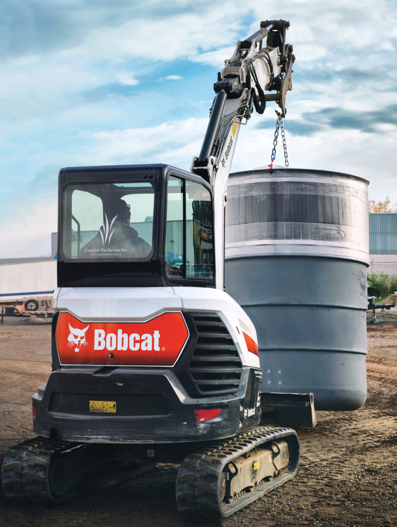 Bobcat excavator moves Molok container