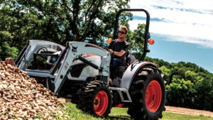 Bobcat CT4045 Compact Tractor Moves Landscape Rocks On Acreage