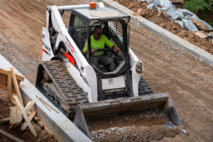 Bobcat Compact Track Loader Grading A Bike Trail With Bucket Attachment