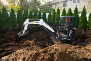 Bobcat Mini Excavator Digging Dirt For Pool Installation